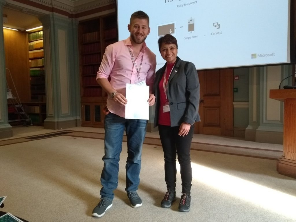 James McAllister, University of Glasgow, being presented with his prize certificate by Pooja Goddard (RSC Dalton/Loughborough University). Photo © Royal Society of Chemistry